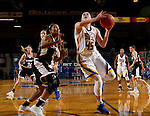 BROOKINGS, SD - JANUARY 7:  Ellie Thompson #45 from South Dakota State eyes the basket past Jay Bridgeman #40 from the University of Nebraska Omaha during their game Saturday afternoon at Frost Arena in Brookings. (Dave Eggen/Inertia)
