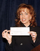 Paula Jones shows off the one million dollar check given to her by Abe Hirschfeld in an attempt to settle her sexual harassment lawsuit against United States President Bill Clinton at the Mayflower Hotel in Washington, DC on 31 October, 1998.<br /> Credit: Ron Sachs / CNP
