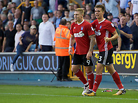 Martyn Waghorn of Ipswich Town (left) celebrates with Jonas Knudsen of Ipswich Town after scoring to make it 1-2 during the Sky Bet Championship match between Millwall and Ipswich Town at The Den, London, England on 15 August 2017. Photo by Alan  Stanford / PRiME Media Images.