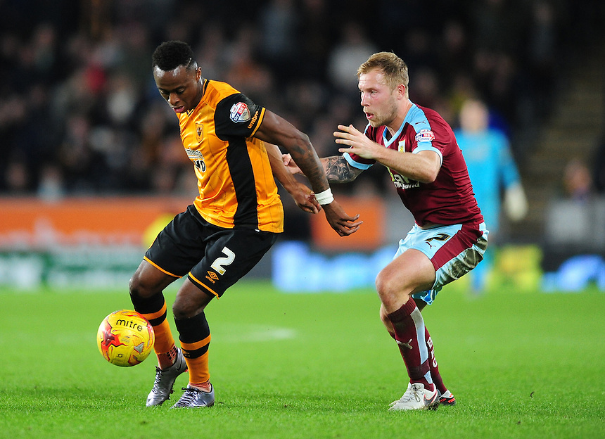 Hull City&rsquo;s Moses Odubajo shields the ball from Burnley's Scott Arfield<br /> <br /> Photographer Chris Vaughan/CameraSport<br /> <br /> Football - The Football League Sky Bet Championship - Hull City v Burnley - Saturday 26th December 2015 - Kingston Communications Stadium - Hull<br /> <br /> &copy; CameraSport - 43 Linden Ave. Countesthorpe. Leicester. England. LE8 5PG - Tel: +44 (0) 116 277 4147 - admin@camerasport.com - www.camerasport.com