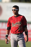 Fidel Pena #23 of the Visalia Rawhide warms up before a game against the Inland Empire 66ers at San Manuel Stadium on June 12, 2014 in San Bernardino, California. Inland Empire defeated Visalia, 4-2. (Larry Goren/Four Seam Images)