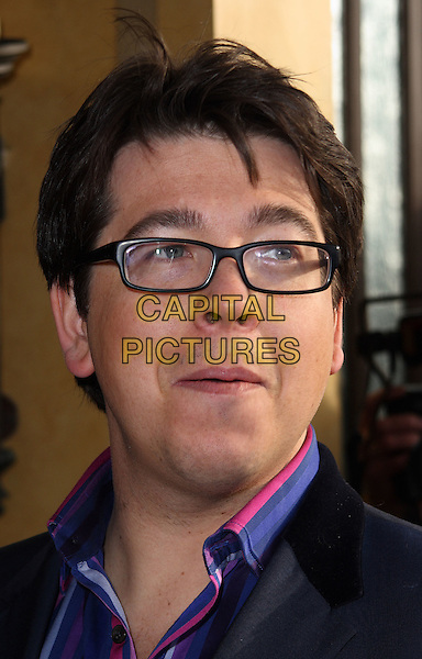 MICHAEL McINTYRE .Attending the South Bank Show Awards at the Dorchester Hotel, Park Lane, London, England, UK, .January 26th 2010..outside arrivals portrait headshot glasses pink purple blue shirt striped .CAP/JIL.©Jill Mayhew/Capital Pictures