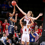 SIOUX FALLS, SD - MARCH 7: Abigail Fogg #44 of South Dakota blocks the shot of Bria Pitts #5 of Oral Roberts in the 2016 Summit League Tournament. (Photo by Dave Eggen/Inertia)
