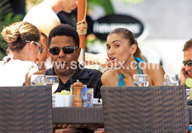**ALL ROUND PICTURES FROM SOLARPIX.COM**.**WORLDWIDE SYNDICATION RIGHTS**.Tito Jackson and girl friend out for lunch at Buddha Beach in Marbella this afternoon. The couple ordered a good old american burger and salad while they slurped their drinks through straws and watched people jet skiing on the Med..JOB REF:  22.07.09  AB1       DATE:  22.07.09.**MUST CREDIT SOLARPIX.COM OR DOUBLE FEE WILL BE CHARGED**.**ONLINE USAGE FEE  GBP 50.00 PER PICTURE - NOTIFICATION OF USAGE TO PHOTO @ SOLARPIX.COM**.**CALL SOLARPIX : +34 952 811 768 or LOW RATE FROM UK 0844 617 7637**