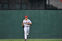 Center fielder Andrew Benintendi (2) of the Greenville Drive runs in from the outfield in a game against the Greensboro Grasshoppers on Tuesday, August 25, 2015, at Fluor Field at the West End in Greenville, South Carolina. Benintendi is a first-round pick of the Boston Red Sox in the 2015 First-Year Player Draft out of the University of Arkansas. Greensboro won, 3-2. (Tom Priddy/Four Seam Images)