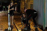 Pictured: A young woman is helped by her boyfriend in Wind Street, Swansea, Wales, UK. Friday 20 December 2019<br /> Re: Black Eye Friday (also known as Black Friday, Mad Friday, Frantic Friday) the last Friday before Christmas, in Swansea, Wales, UK.
