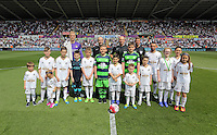 Children mascots with Leon Britton, Joe Hart, referee Mike Dean before kick off at the Swansea City FC v Manchester City Premier League game at the Liberty Stadium, Swansea, Wales, UK, Sunday 15 May 2016