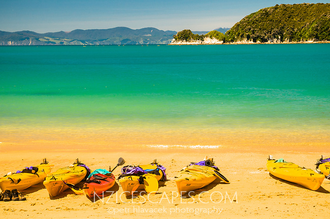 Lined up kayaks at Watering Cove on Abel Tasman Coastal Track, Abel Tasman National Park, Nelson Region, New Zealand