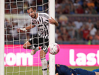 Calcio, Serie A: Roma vs Juventus. Roma, stadio Olimpico, 30 agosto 2015.<br /> Juventus&rsquo; Giorgio Chiellini looks at the ball as Roma&rsquo;s goalkeeper Wojciech Szczesny, bottom, lies on the pitch during the Italian Serie A football match between Roma and Juventus at Rome's Olympic stadium, 30 August 2015.<br /> UPDATE IMAGES PRESS/Isabella Bonotto