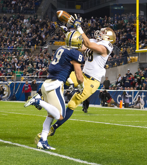 Nov. 9, 2013; Tight end Ben Koyack (18) catches a pass over Pittsburgh Panthers safety Ray Vinopal (9) in the second quarter. The play appeared to result in an Irish touchdown but Koyak was ruled down in a review of the play.
