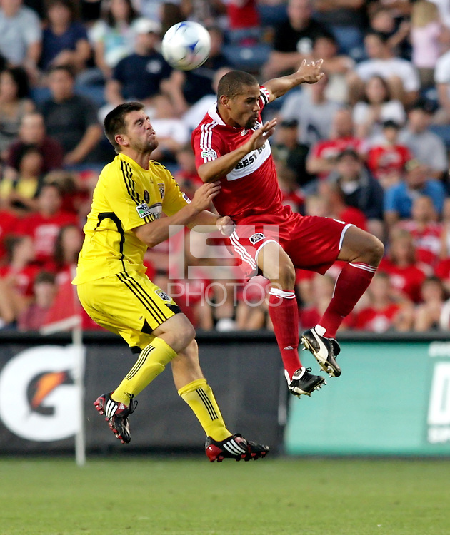 Columbus Crew forward Jason Garey (9) and Chicago Fire defender C.J. Brown (2) go up for a header.  The Chicago Fire tied the Columbus Crew 0-0 at Toyota Park in Bridgeview, IL on July 11, 2009.