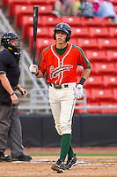 Christian Yelich #7 of the Greensboro Grasshoppers walks back to the dugout after taking a called third strike against the Hickory Crawdads at L.P. Frans Stadium on May 18, 2011 in Hickory, North Carolina.   Photo by Brian Westerholt / Four Seam Images