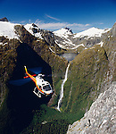 Squirrel helicopter with tourists near Lake Quill and the Sutherland Falls Fiordland National Park New Zealand