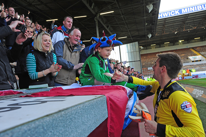 Burnley's Thomas Heaton hands his gloves to a young fan at the end of the game<br /> <br /> Photo by Chris Vaughan/CameraSport<br /> <br /> Football - The Football League Sky Bet Championship - Burnley v Ipswich Town - Saturday 26th April 2014 - Turf Moor - Burnley<br /> <br /> &copy; CameraSport - 43 Linden Ave. Countesthorpe. Leicester. England. LE8 5PG - Tel: +44 (0) 116 277 4147 - admin@camerasport.com - www.camerasport.com