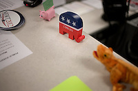 A lizard-shaped stuffed animal and Republican elephant figurine that says C-SPAN 2012 rest on the reception desk at the Newt Gingrich New Hampshire campaign headquarters in Manchester, New Hampshire, on Jan. 7, 2012. Gingrich is seeking the 2012 Republican presidential nomination.