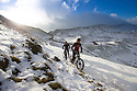 29/12/14<br /> <br /> After the lowest overnight temperatures recorded this winter, Nick Clayton (leading) and Mark Brind cycle along a snow covered bridleway on the edge of Mam Tor in the Derbyshire Peak District near Castleton.<br /> <br /> <br /> All Rights Reserved - F Stop Press. www.fstoppress.com. Tel: +44 (0)1335 300098