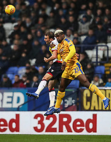 Bolton Wanderers' Christian Doidge competing with Wigan Athletic's Cedric Kipre<br /> <br /> Photographer Andrew Kearns/CameraSport<br /> <br /> The EFL Sky Bet Championship - Bolton Wanderers v Wigan Athletic - Saturday 1st December 2018 - University of Bolton Stadium - Bolton<br /> <br /> World Copyright © 2018 CameraSport. All rights reserved. 43 Linden Ave. Countesthorpe. Leicester. England. LE8 5PG - Tel: +44 (0) 116 277 4147 - admin@camerasport.com - www.camerasport.com