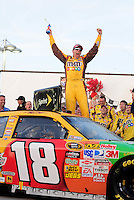 Mar. 1, 2009; Las Vegas, NV, USA; NASCAR Sprint Cup Series driver Kyle Busch celebrates after winning the Shelby 427 at Las Vegas Motor Speedway. Mandatory Credit: Mark J. Rebilas-