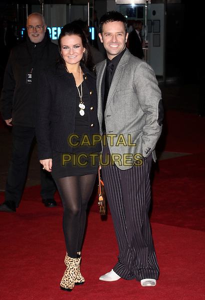 LILIA KOPYLOVA & DARREN BENNETT.Attending the World Premiere of the film 'NINE' held at the Odeon cinema Leicester Square, London, England, UK,  3rd December 2009..full length married couple husband wife leopard print ankle boots black tights dress jacket grey gray pinstripe striped trousers .CAP/AH.©Adam Houghton/Capital Pictures.