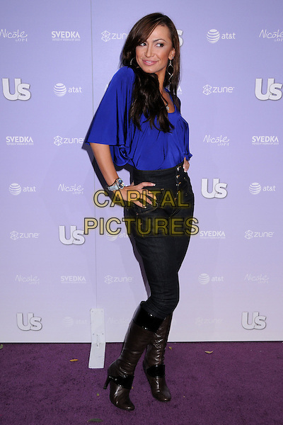 KARINA SMIRNOFF.US Weekly's Hot Hollywood 2008 Party at Beso Restaurant, Hollywood, California, USA..April 17th, 2008.full length blue purple blouse top high waist waisted jeans denim tucked into black boots hand on hip .CAP/ADM/BP.©Byron Purvis/AdMedia/Capital Pictures.