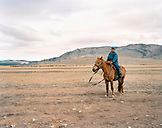 MONGOLIA, Khuvsgul National Park, a young boy shepherd tends to his livestock