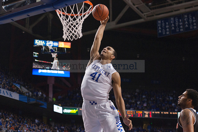Forward Trey Lyles of the Kentucky Wildcats dunks during the second half of the game against the University of Georgetown Tigers at Rupp Arena on Sunday, November 9, 2014 in Lexington, Ky. Kentucky defeated Georgetown 121-52. Photo by Michael Reaves | Staff