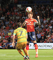 Luton Town midfielder Jordan Cook gets a head to the ball during the Sky Bet League 2 match between Luton Town and Yeovil Town at Kenilworth Road, Luton, England on 13 August 2016. Photo by Liam Smith.