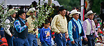 Generations of Crow men dance to honor a family member during a give-away dance during Crow Fair.