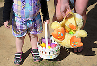 FAIRLESS HILLS, PA - APRIL 12:  Blake Murphy, 2, of Fairless Hills, Pennsylvania holds her Easter basket filled with eggs during the YMCA Easter Egg Hunt April 12, 2014 in Fairless Hills Pennsylvania. (Photo by William Thomas Cain/Cain Images)