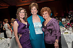 Emily Davis with HAWC Honoree Linda McCollum and guest at the Houston Area Women's Center 2011 Gala with Joan Rivers.