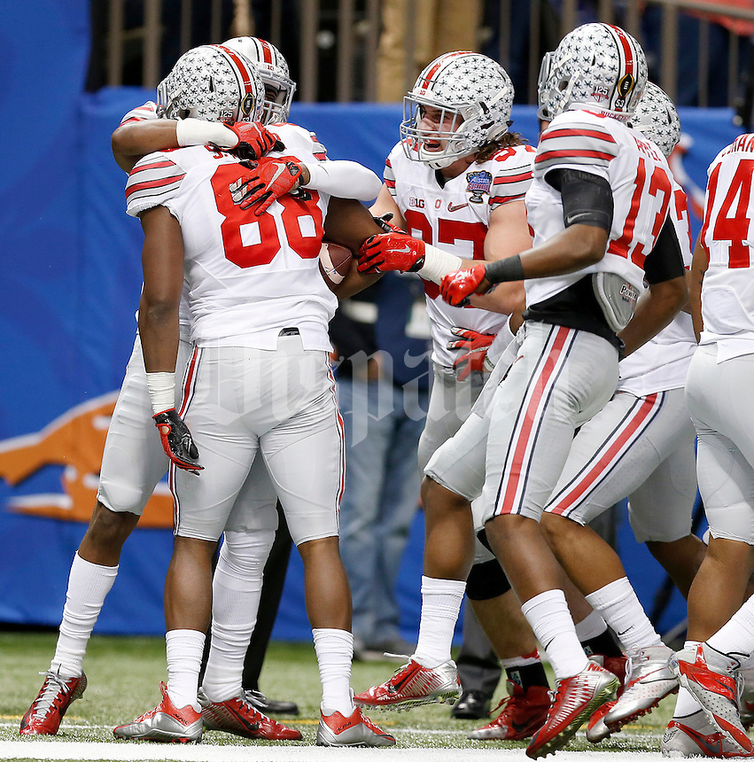 Ohio State Buckeyes defensive lineman Steve Miller (88) is congratulated by teammates after his interception for a touchdown during the third quarter in the Allstate Sugar Bowl college football playoff semifinal at Mercedes-Benz Superdome in New Orleans on Thursday, January 1, 2015. (Columbus Dispatch photo by Jonathan Quilter)