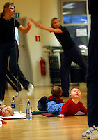 Seven month old Mikkel Grunnan doesn't quite understand what is going on, but he pays close attention at his mother's aerobics class..In contrast to most European countries, the Norwegian birth rate is a healthy 1.9. Norway's reputation as a child friendly society is partially founded on a succession of government initiatives to improve parents' rights and economic circumstances.