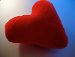 A macro shot of a felt heart
