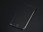 Apple iPhone 7 Plus with blank screen isolated on shiny black background