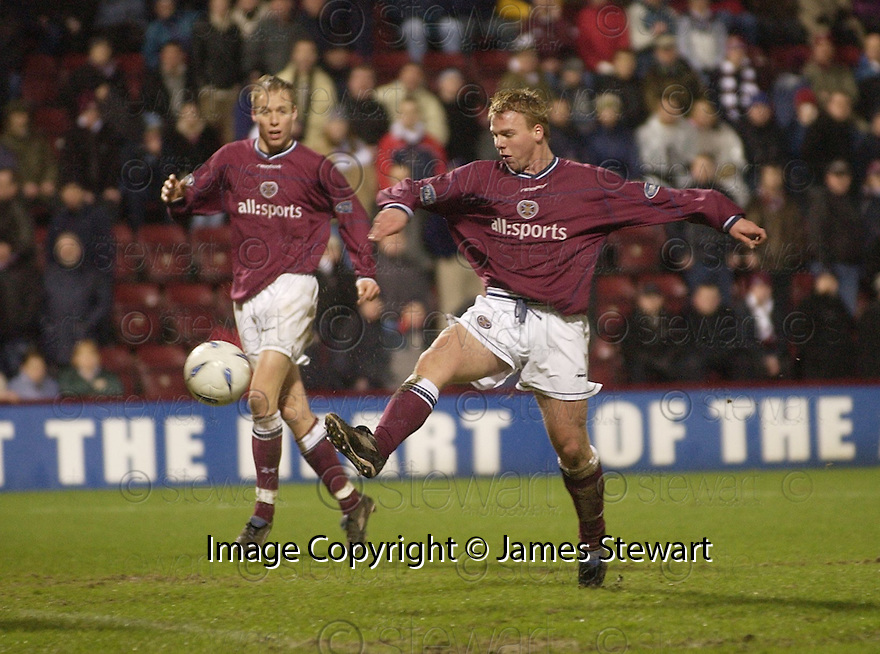 02/01/2003                   Copyright Pic : James Stewart.File Name : stewart-hearts v hibs 17.GRAHAM WEIR KNOCKS HOME HEARTS THIRD GOAL.....James Stewart Photo Agency, 19 Carronlea Drive, Falkirk. FK2 8DN      Vat Reg No. 607 6932 25.Office     : +44 (0)1324 570906     .Mobile  : +44 (0)7721 416997.Fax         :  +44 (0)1324 570906.E-mail  :  jim@jspa.co.uk.If you require further information then contact Jim Stewart on any of the numbers above.........