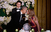 United States President Barack Obama, center, kisses Mrs. Sophie Gr&eacute;goire Trudeau of Canada after offering a toast during a state dinner honoring her and Prime Minister Justin Trudeau of Canada, left, at the White House March 10, 2016 in Washington, DC. <br /> Credit: Olivier Douliery / Pool via CNP