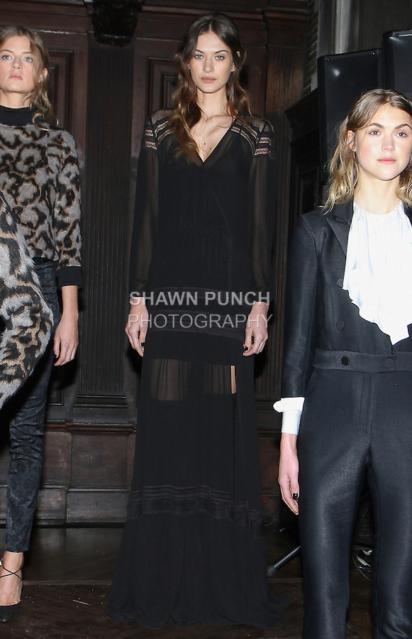 "Model Jacqueline poses in a black washed chiffon lace trim gown, from the Veronica Beard Fall 2016 ""Gypsy Caravan"" collection presentation, at the Highline Hotel on February 15 2016, during New York Fashion Week Fall 2016."