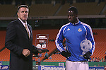 "27 October 2007: Kansas City Technical Director Peter Vermes holds an award reading ""Josh Wolff Team MVP"" as Eddie Johnson (r) expects to receive an award with his name on it. The Kansas City Wizards defeated Club Deportivo Chivas USA 1-0 in the first leg of their Major League Soccer Western Conference Semifinal playoff series at Arrowhead Stadium in Kansas City, Missouri."