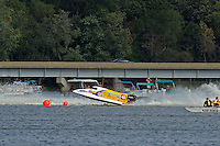 Kris Shepard, (#46) gets a little high in the first turn of the final. (SST-120 class)