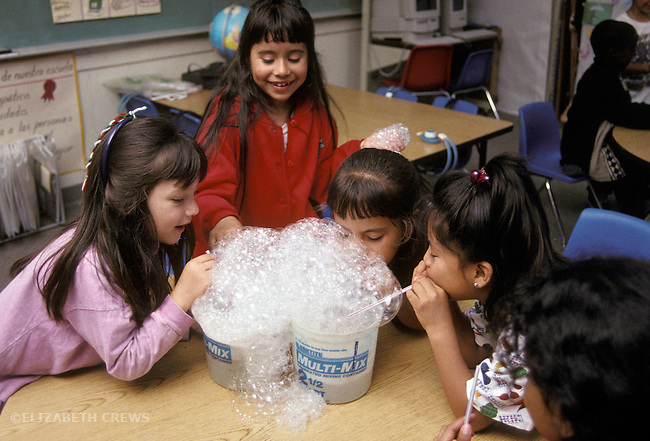 San Rafael CA Latina first graders studying matter by observing properties of water, soap and bubbles