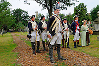 Soldiers, and wife, of the 6th Connecticut Regiment stand easy during a July Fourth ceremony to recognize fallen patriots of the Revolutionary War, Grove Street Cemetery, New Haven, Connecticut, USA.