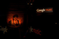 Los Angeles, California, November 16, 2011 – Google Music logos interspersed with original art by Mr. Brainwash seen through a prism at Brainwash's Studio during the release of Google Music. ..In an attempt to take on rival Apple and it's mega music platform iTunes, Google launched its music service – Google Music – today at Mr. Brainwash's Studio in Los Angeles. The service update integrates a music section into Google's Android Market, Google's media hub for Android devices. Users can now purchase songs through the Android market, and can stream them wirelessly to their Android phones and tablets using the Google Music app. In a tie-in to another of Google's flagship products, the company is integrating the music store into its newly launched social network, Google Plus. In order to entice new adopters, the company will launch a series of Google Music-exclusive tracks, including live sets from the Rolling Stones, Coldplay and Busta Rhymes, who was in the audience.