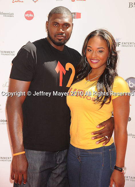 CULVER CITY, CA. - September 10: NBA athlete Jason Maxiell and wife Brandi Maxiell arrive at Stand Up To Cancer at Sony Pictures Studios on September 10, 2010 in Culver City, California.
