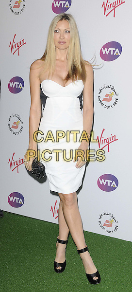 Caprice Bourret.The WTA Pre-Wimbledon Party, The Roof Gardens, Kensington High St., London, England..June 21st, 2012.full length white black strapless dress clutch bag ankle strap shoes .CAP/CAN .©Can Nguyen/Capital Pictures.