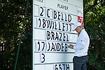 A member of the staff updates the leaderboard during the 58th UBS Hong Kong Golf Open as part of the European Tour on 09 December 2016, at the Hong Kong Golf Club, Fanling, Hong Kong, China. Photo by Marcio Rodrigo Machado / Power Sport Images