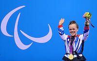 PICTURE BY ALEX BROADWAY /SWPIX.COM - 2012 London Paralympic Games - Day Three - Swimming - Aquatics Centre, Olympic Park, London, England - 01/09/12 - Eleanor Simmonds of Great Britain poses with her medal after winning Gold in the Women's 400m Freestyle S6 Final.