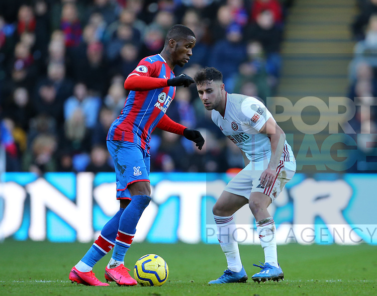 Christian Benteke of Crystal Palace tacklesd by George Baldock of Sheffield Utd during the Premier League match at Selhurst Park, London. Picture date: 1st February 2020. Picture credit should read: Paul Terry/Sportimage