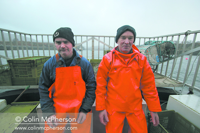 Fishermen John Macgregor (right) and Davie Smith take a break on board the My Amber, after a day's fishing for prawns off Scotland's west coast in a marine 'box' in the inner sound of Rona which restricts entry to large trawlers looking for white fish and allows around 16 creelers unrestricted fishing.