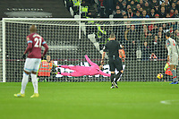Aaron Cresswell of West Ham United shoots wide during West Ham United vs Liverpool, Premier League Football at The London Stadium on 4th February 2019