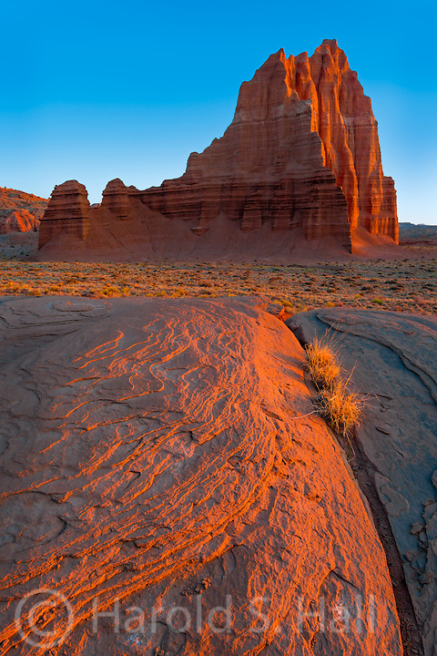 The sun rises at the Temple of the Sun in Capitol Reef National Park Utah.